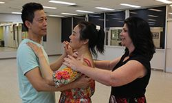A couple receiving instruction in ballroom dancing