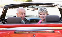 Senior adults in a convertible car